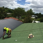 Preparing the mounting feet for a solar power install in Indooroopilly